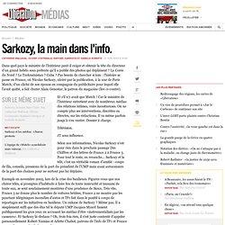 Sarkozy, la main dans l'info.