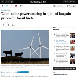 Wind, solar power soaring in spite of bargain prices for fossil fuels
