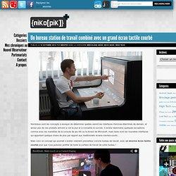 Un bureau station de travail combiné avec un grand écran tactile courbé