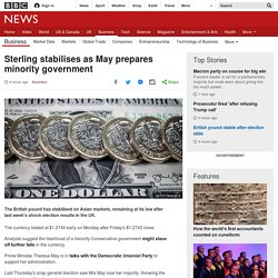 Sterling stabilises as May prepares minority government