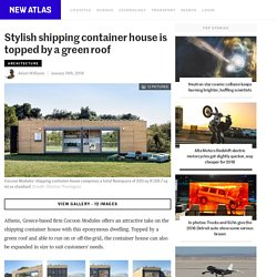 Stylish shipping container house is topped by a green roof