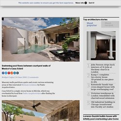 Swimming pool flows between courtyard walls of Mexico's Casa Xólotl