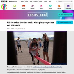 US-Mexico border wall: Kids play together on seesaws - CBBC Newsround