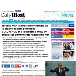 Toronto man is charged after he turned up to anti-racism protest in BLACKFACE