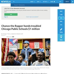 Chance the Rapper hands troubled Chicago Public Schools $1 million