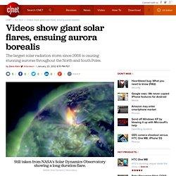 Videos show giant solar flares, ensuing aurora borealis