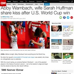 Abby Wambach kisses wife after World Cup win