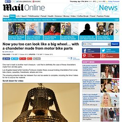Now you too can look like a big wheel¿ with a chandelier made from motor bike parts
