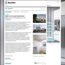 Schweizer Wohnhäuser von Dolmus / Split-Level mit Satteldach