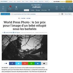 World Press Photo : le 1er prix pour l'image d'un bébé réfugié sous les barbelés