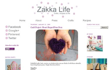 http://zakkalife.blogspot.com/2009/01/craft-project-heart-shaped-pom-poms.html