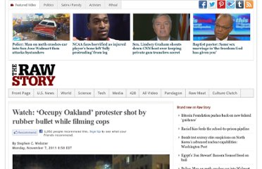 http://www.rawstory.com/rs/2011/11/07/watch-occupy-oakland-protester-shot-by-rubber-bullet-while-filming-cops/