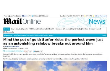 http://www.dailymail.co.uk/news/article-2091023/Mind-pot-gold-Surfer-rides-perfect-wave-just-astonishing-rainbow-breaks-aournd-him.html