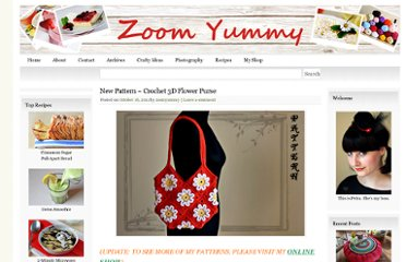 http://zoomyummy.com/2011/10/16/new-pattern-crochet-3d-flower-purse/