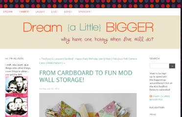 http://www.dreamalittlebigger.com/craft/2012/7/22/from-cardboard-to-fun-mod-wall-storage.html