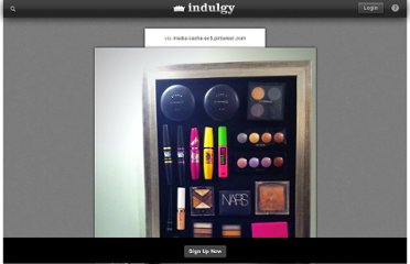http://indulgy.com/post/FQZjjCgDN1/magnetic-makeup-board-cover-a-sheet-of-metal-wit