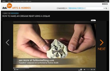 http://on.aol.com/video/how-to-make-an-origami-heart-using-a-dollar-90845925