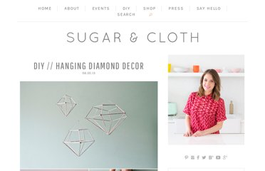 http://sugarandcloth.com/2013/06/diy-hanging-diamond-decor/